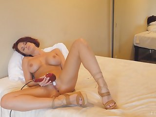 Ravishing MILF brunette Emily Reaches intense orgasm close by a vibrator