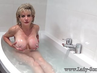 Lassie Sonia takes a bath then rubs her pussy