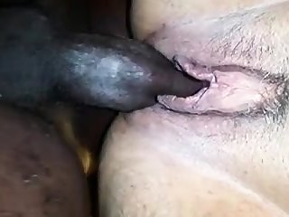 Interracial sucking and jerking big cocks and loves it