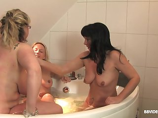 Soapy lesbian hardcore triple in a bathtub with mature babes