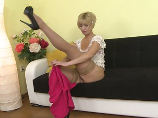 Grown-up layman blonde in stockings Eliena masturbates with toys