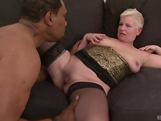 Mature unexpected haired blonde DD gets cum on face from a dark bloke