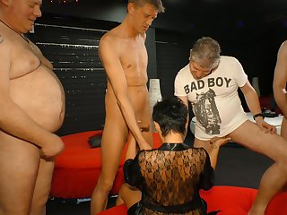 Aged experienced prostitute is fucked hard by four kinky dudes