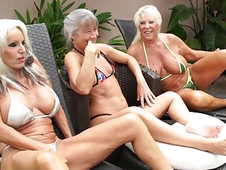 Of age grannies share BBC anent outdoor interracial threesome by the pool