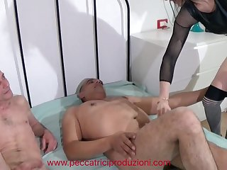 Slim mature whore has pastime with two cocky freaks