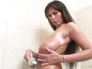 Sexy mollycoddle takes a shower and shows her nice natural boobs