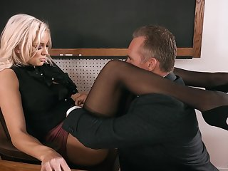Strict looking busty blonde principal Kenzie Taylor lures dude in fuck mad