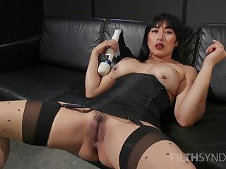 Asian whore sticks large toys in all directions both holes during a rare desolate