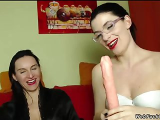 Milf lesbians playing with dildo on cam