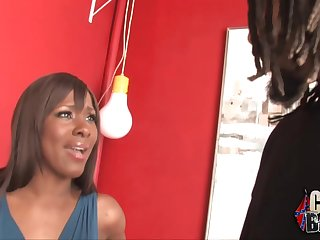 Horny ebony milf is sucking three cocks at the same time and gets cum on her face