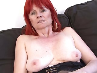 Red haired granny in titillating lingerie is having casual sex with a black guy, insusceptible to burnish apply sofa