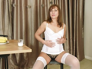 Sex-appeal older woman Rafaella shows striptease relating to the addition of plays relating to pussy