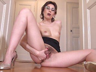 Dirty mature Meggie Marika with glasses enjoys pleasuring her pussy